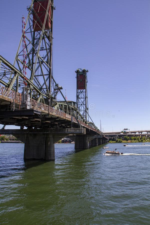 Hawthorne Bridge from an angle on a Late Sunny Summer Afternoon on the Willamette River in Portland Oregon. Vertical image of the Hawthorne Bridge form an angle royalty free stock photos