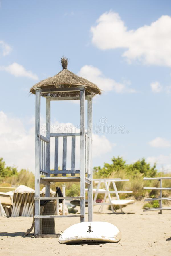 Vertical image of a lifeguard tower with a surfboard royalty free stock photography
