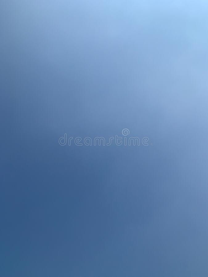 The vertical image of natural blue blue sky background royalty free stock photo