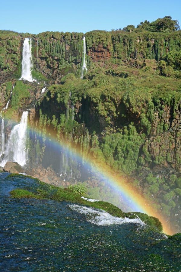 Vertical Image of Powerful Iguazu Falls at Brazilian Side with a Huge Rainbow, Foz do Iguacu, Brazil royalty free stock image