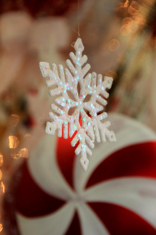 Vertical image of Christmas window with snowflake ornament and peppermint red and white decoration stock images