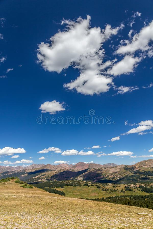 Cloudscape and Gore Range from Shrine Mountain ridge, Colorado Rockies. Vertical image of sky and beautiful clouds over the Gore Range of the Colorado Rockies royalty free stock photo