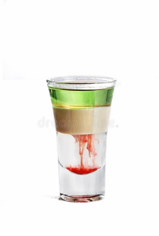 Vertical isolated shot of a multi-colored cocktail in a vodka glass  - perfect for menu usage stock images