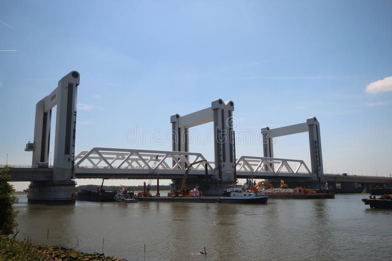 Vertical lift bridge named Botlekbrug with working ships around it stock images