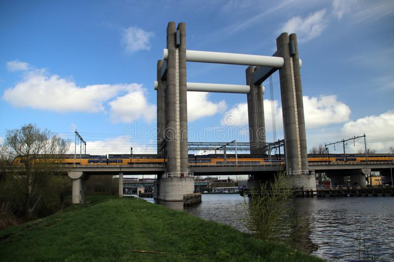 vertical lift bridge for trains in Gouda over canal named Gouwe in the Netherlands. royalty free stock image
