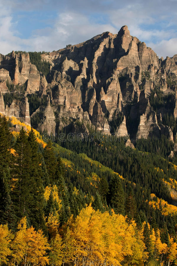 Vertical Mountain Crags. Vertical shot of granite crags of mountain peak in the fall when the aspens are turning color royalty free stock photography