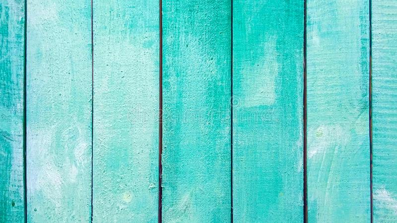Vertical  old green turquoise  wooden background with shabby paint planks. Wooden texture. Panel consisting of old wooden boards royalty free stock images