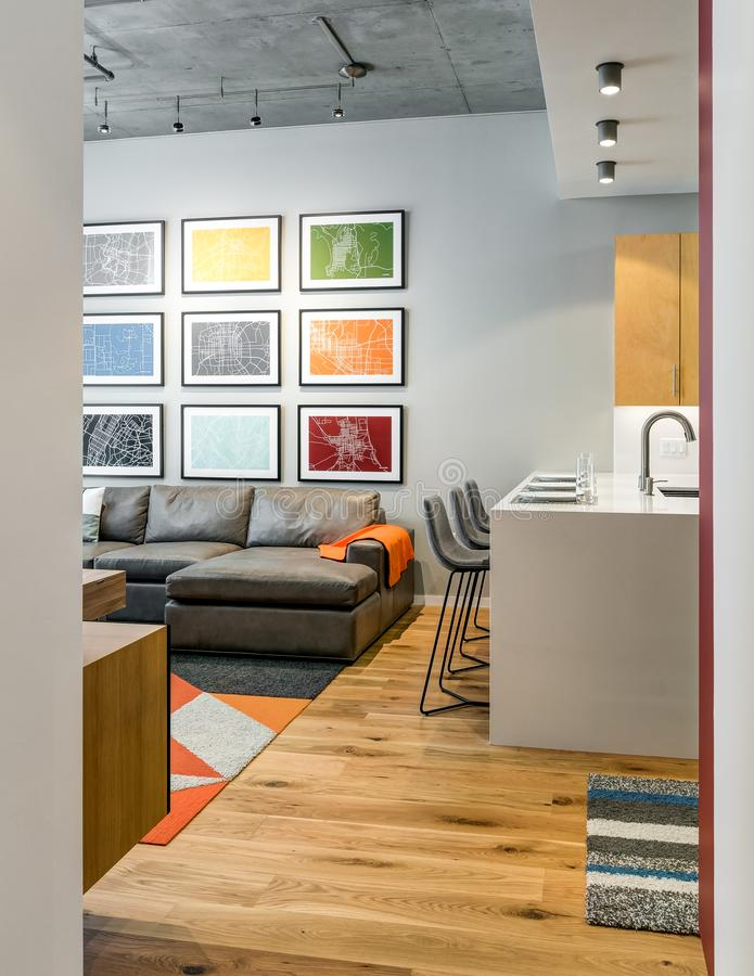 Vertical orientation of view into modern living space and kitchen stock image
