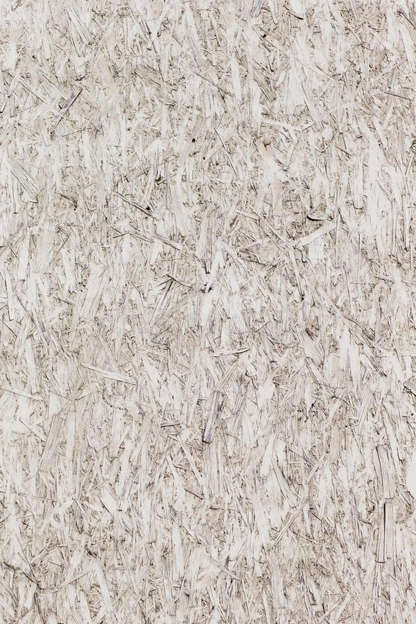 Vertical oriented strand board. White painted chipboard royalty free stock image