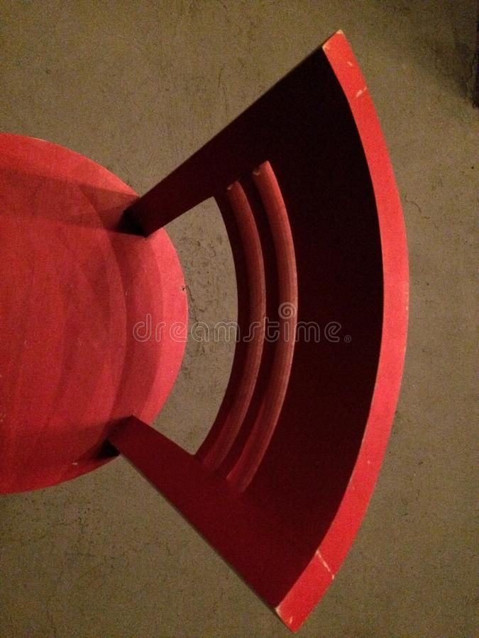 Vertical overhead shot of a red chair on a brown carpet royalty free stock photos