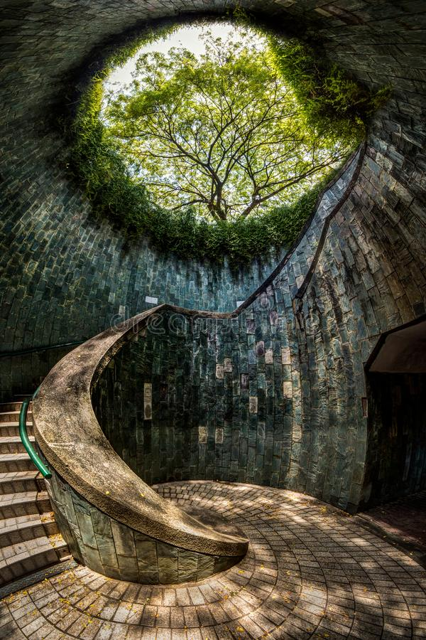 A vertical panorama of a spiral staircase at Fort Canning Park, Singapore. Panoramic view of a spiral staircase of an underground crossing in tunnel at Fort stock photography