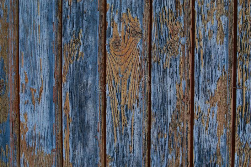 Vertical parallel boards gray weathered old wooden surface grunge style background. Old boards flaking paint stock image