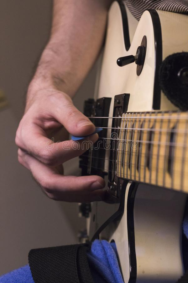 Vertical perspective guitar practice under the dim light royalty free stock images