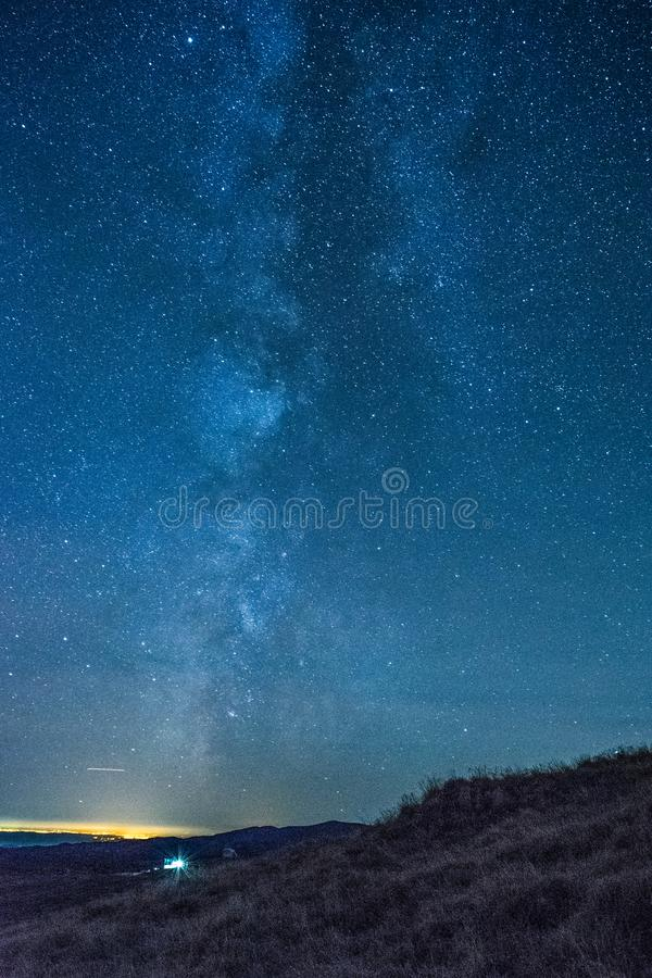 Vertical perspective of Milky Way. Vertical perspective of Milky Way shot in Bucegi mountains, Romania stock images