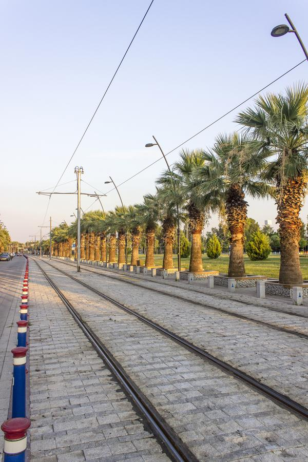 Vertical perspective shot of tramway line with pedestrian stones at sunset time in Izmir at Turkey. In summertime royalty free stock photo