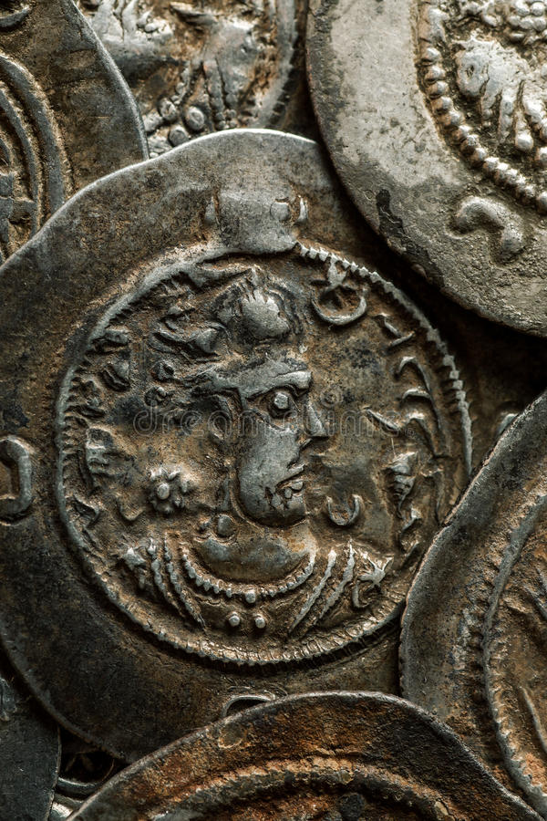 Vertical photo of ancient silver Sassanian coins stock photo