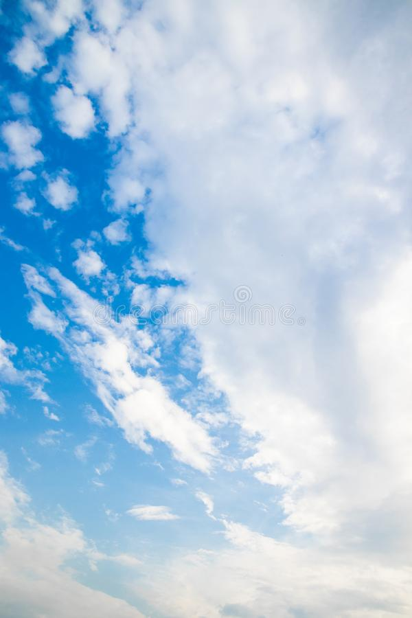 Vertical photo with a beautiful blue sky with white fluffy clouds royalty free stock images