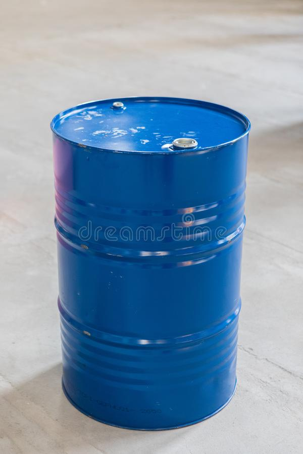 Vertical Photo Of A Blue Metal Oil Barrel. On A Concrete Background royalty free stock image