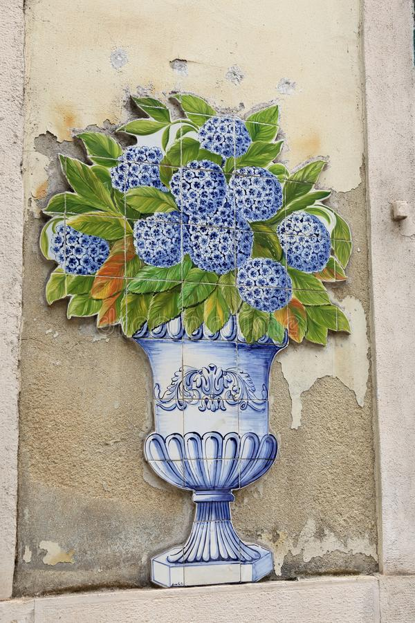 Vertical photo of blue and white traditional decorative painted tiles stock image