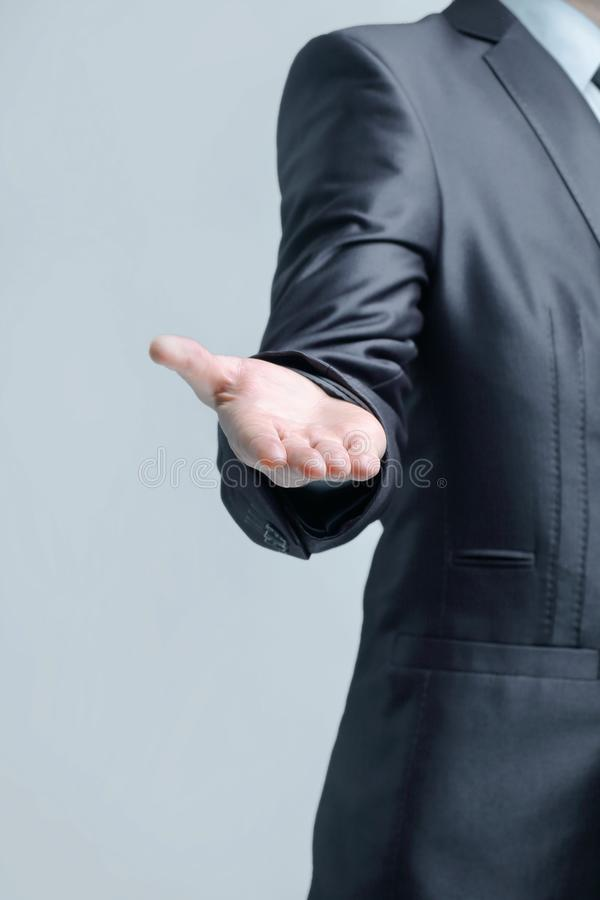 Vertical photo.businessman holds out his hand for a handshake stock photo