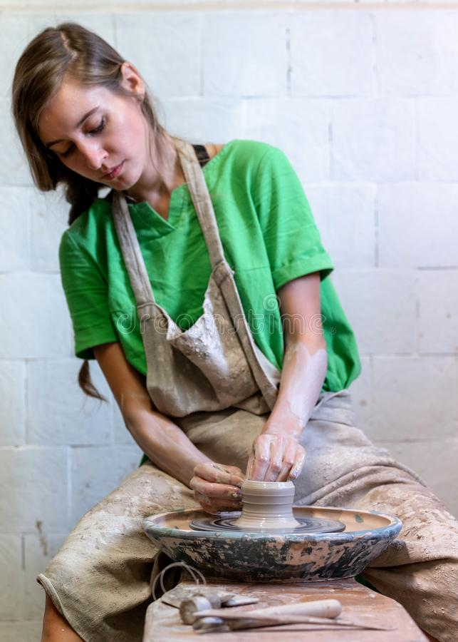 Vertical photo of charming nice-looking lovely cute sweet gorgeous workmanship focused confident artisan artist lady in her stock photo