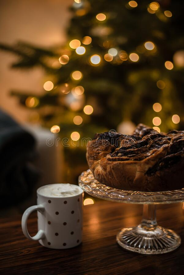 Vertical photo of chocolate wreath in front of a Christmas tree royalty free stock photography