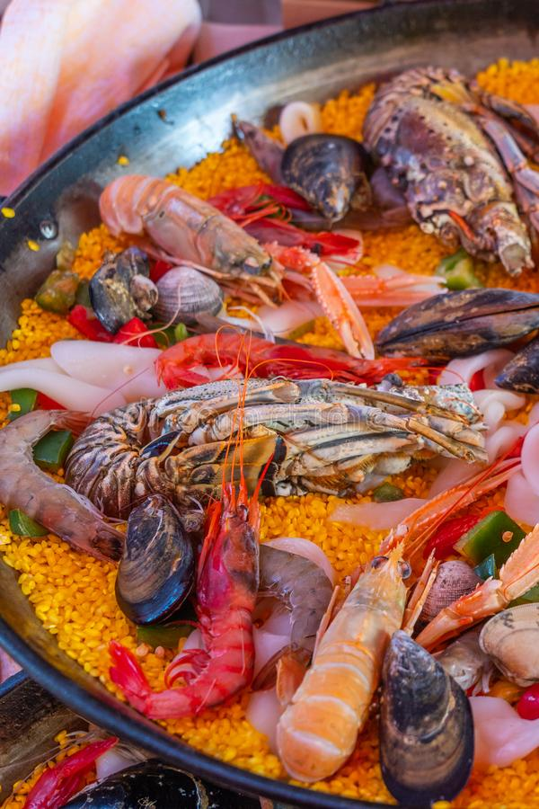 Vertical photo of delicious paella seafood rice recipe of Spain royalty free stock photography