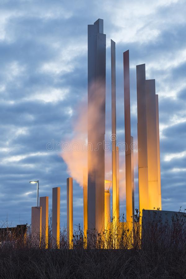 Vertical photo of illuminated steamy modern sculpture in the entrance to the Montreal Casino stock images