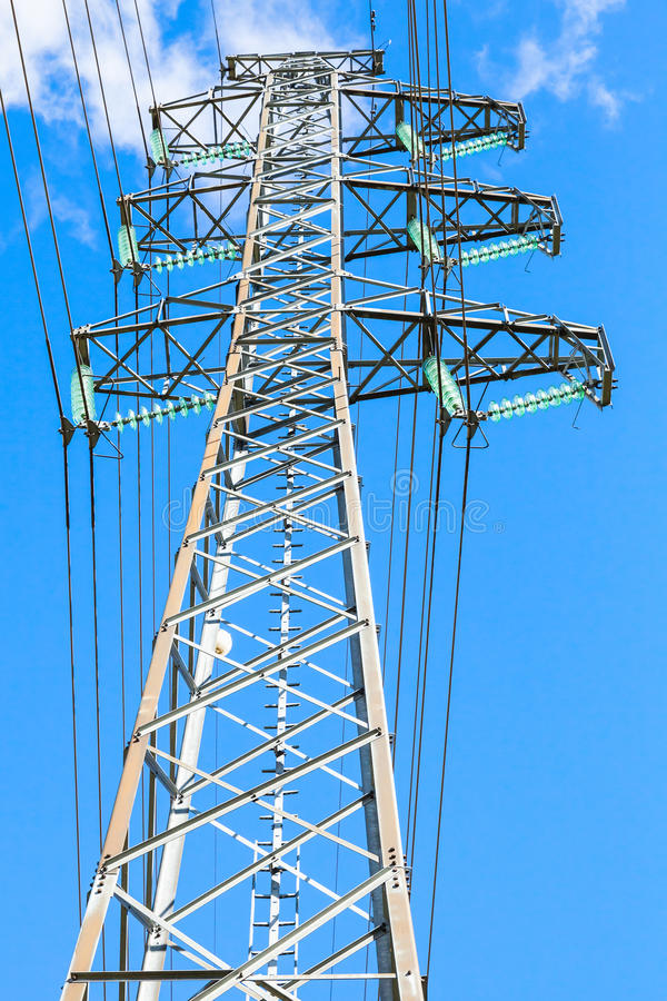 Vertical photo of lattice-type steel tower. As a part of high-voltage line. Overhead power line details royalty free stock image