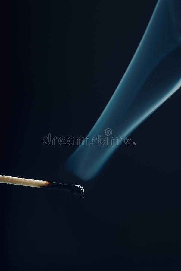 Match stick with burnt head and smoke around royalty free stock photos
