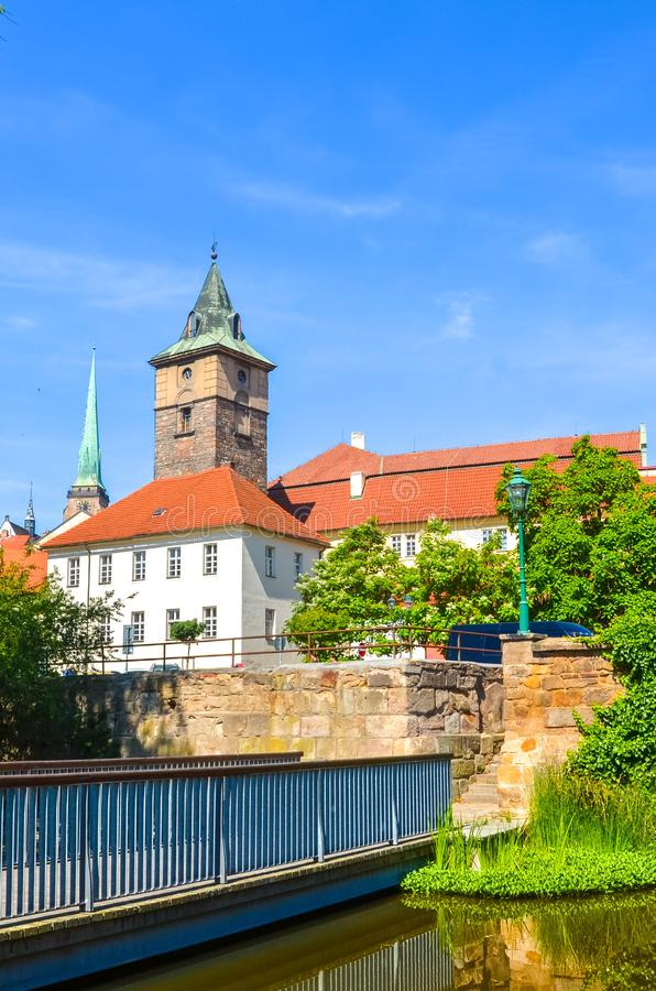Vertical photo of Pilsen, Western Bohemia, Czech Republic with dominant Water Tower, Vodarenska vez in Czech, photographed from. The park by Mlynska Strouha royalty free stock photos