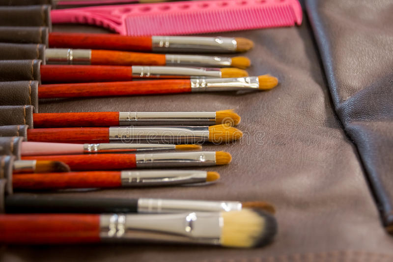 Vertical Photo. Set of make-up brushes in black makeup bag. Beauty tools for professional visage stock photo