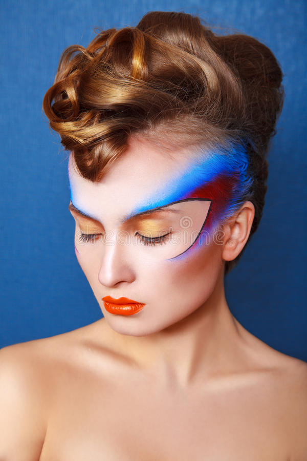 Vertical photo of woman with creative make up and hairstyle. In studio stock image
