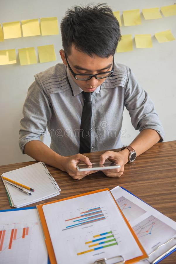 Young businessman using tablet in the office stock photography