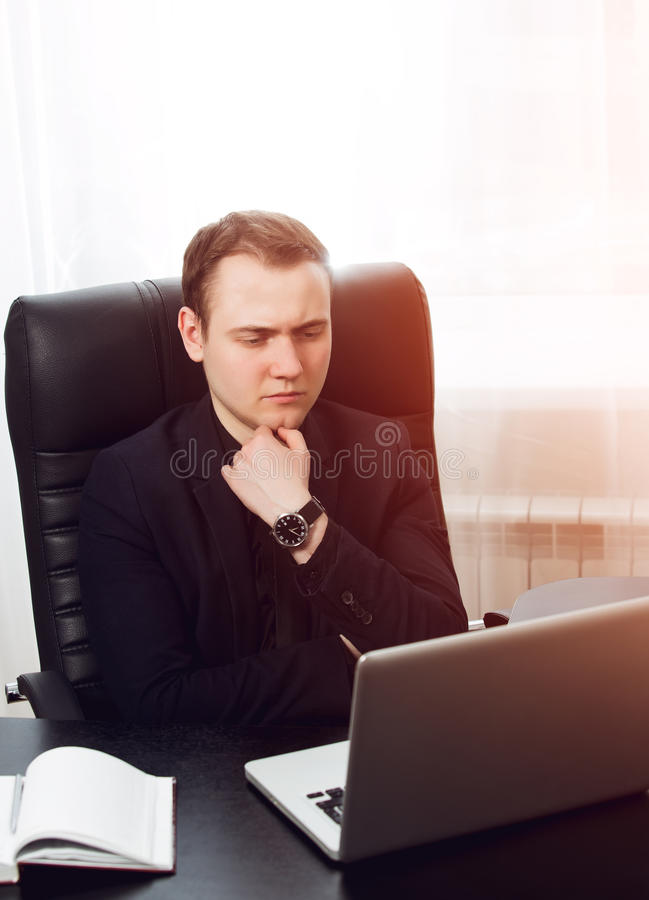 Vertical photo of young concentrated businessman thinnking about business plan royalty free stock images