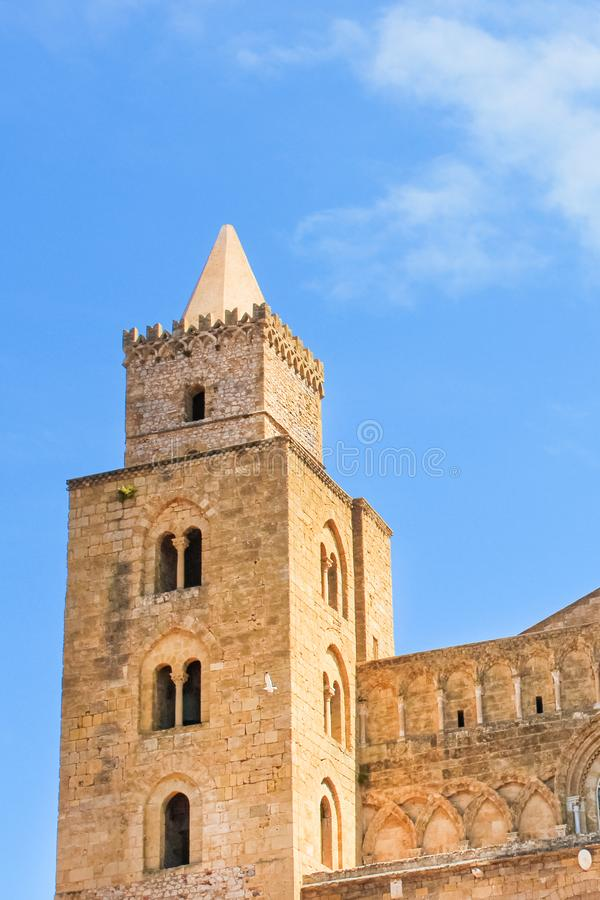 Vertical picture capturing detail of one of the towers belonging to Cefalu Cathedral in Sicily, Italy. Roman Catholic basilica. In Norman architectural style is royalty free stock images