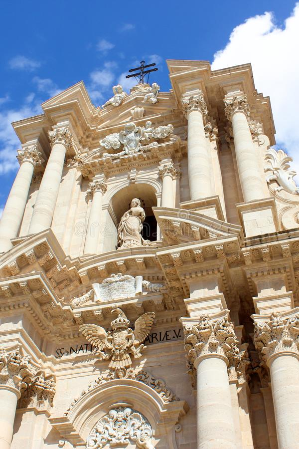 Vertical picture capturing historical Roman Catholic Cathedral of Syracuse in Sicily, Italy on a sunny day. The religious templ, part of UNESCO World Heritage stock photo