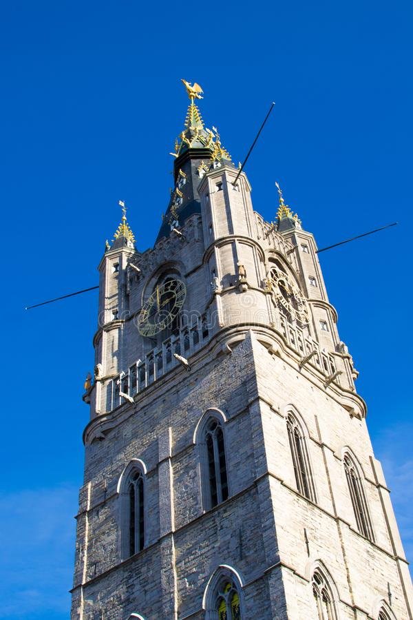 Vertical picture of the medieval tower of the Belfry Het Belfort of Ghent, Belgium, Europe. Tallest bell tower in Belgium with. 91-meters high stock photography