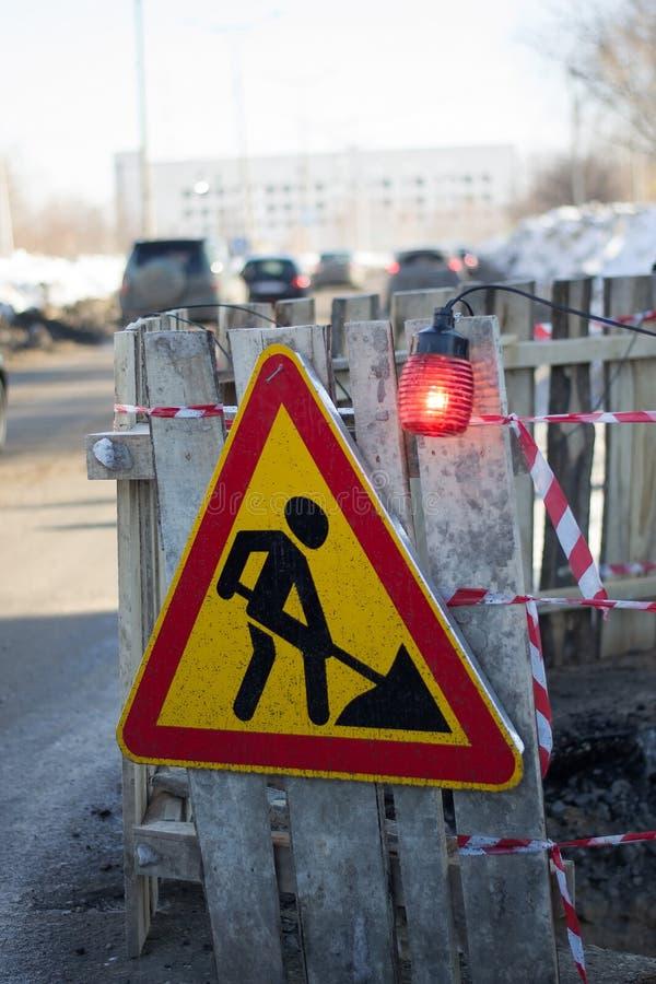 Road sign repair work. Vertical picture of road sign road repair work stock photography