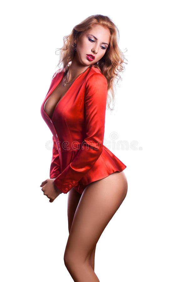 Vertical picture of business woman in red jacket and pantie. S on white background royalty free stock photography