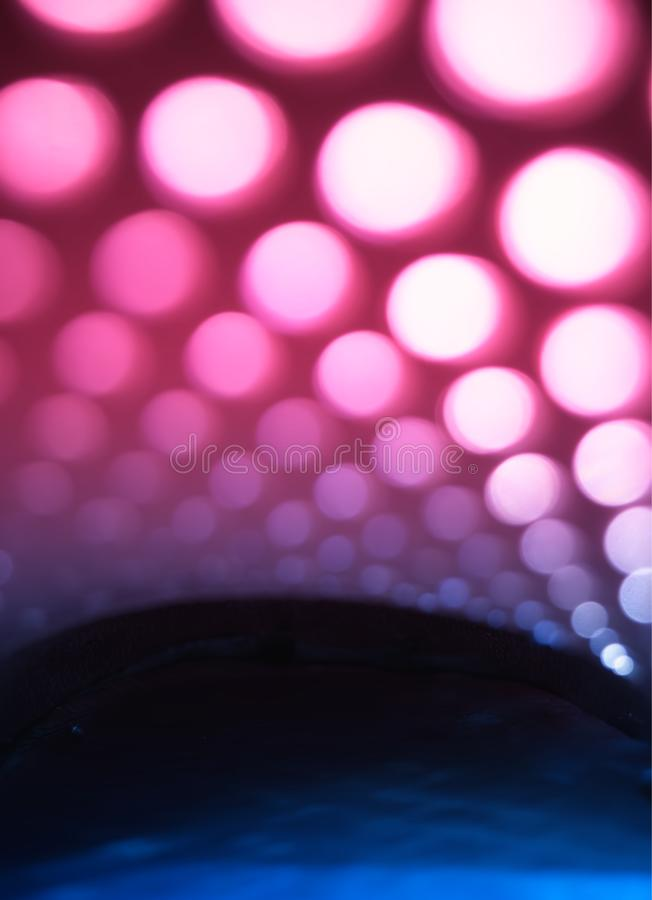 Vertical pink and blue light circles abstract background stock images