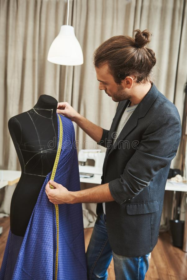 Vertical portrait of adult good-looking caucasian male fashion designer with stylish hairstyle in fashionable outfit in stock images