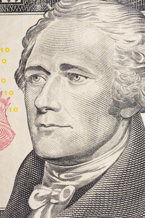 Vertical portrait of Alexander Hamilton`s face on the US 10 dollar bill. Macro shot.  stock image