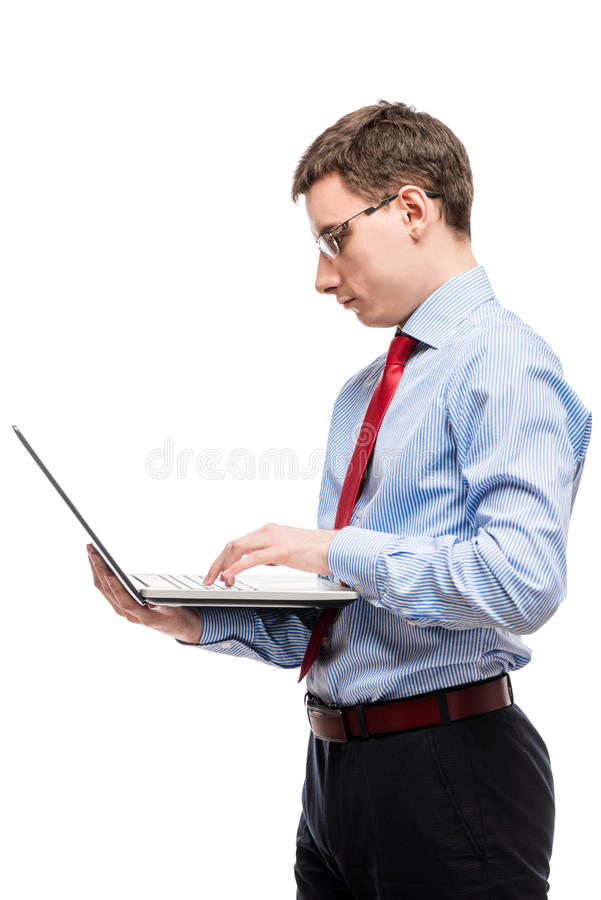 Vertical portrait of a chief accountant in glasses with a laptop royalty free stock image