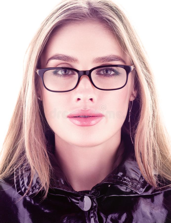 Vertical portrait face closeup. Beautiful young woman wearing glasses royalty free stock photography