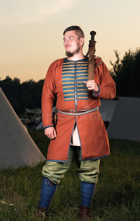 Vertical portrait in full growth of the Slavic soldiers in historic costume royalty free stock photo