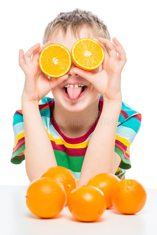 Vertical portrait of a funny boy with oranges on a white stock images