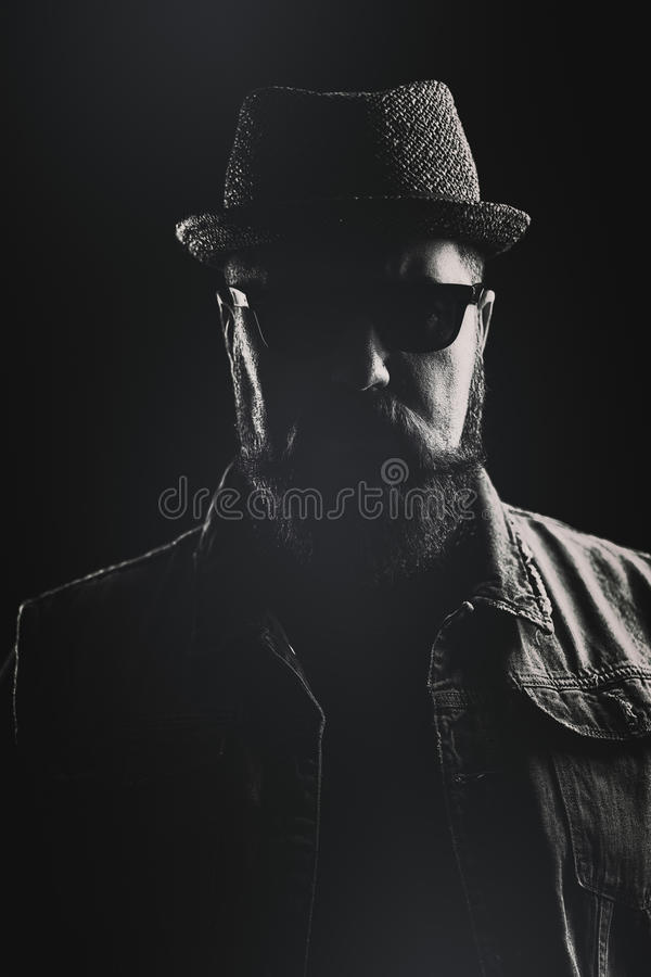 Vertical portrait of a hipster with a pork pie hat and a thick b royalty free stock photos