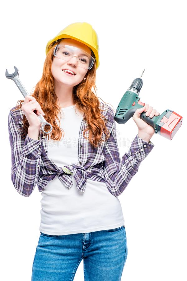 vertical portrait of a woman with red hair with tools stock image