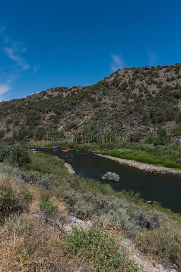 Vertical of a raft on the Rio Grande. The Rio Grande as it flows through northern New Mexico. It provides recreation for many. Photo taken  July 3rd. 2018, rio royalty free stock photo